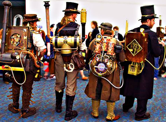 Four steampunkers with strange machines on their back