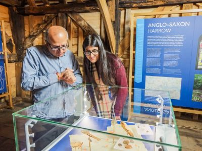 Adult and child looking intently at an Anglo-Saxon exhibit