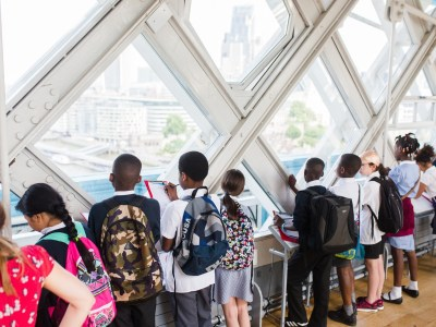 School pupils view the skyline from Tower Bridge's high level walkways as part of a D&T workshop
