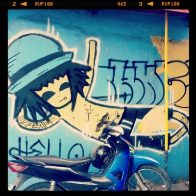 blue graffiti of a boy with a hat