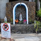 No Parking sign in front of a street Virgin Mary grotto, February 2015