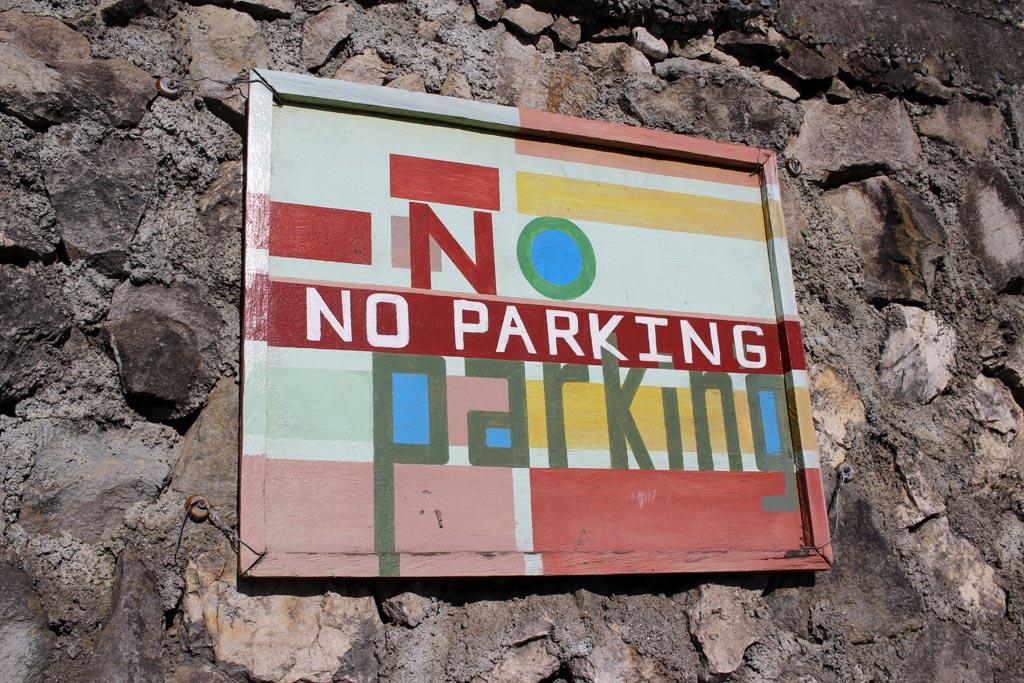 artsy No Parking sign on rock