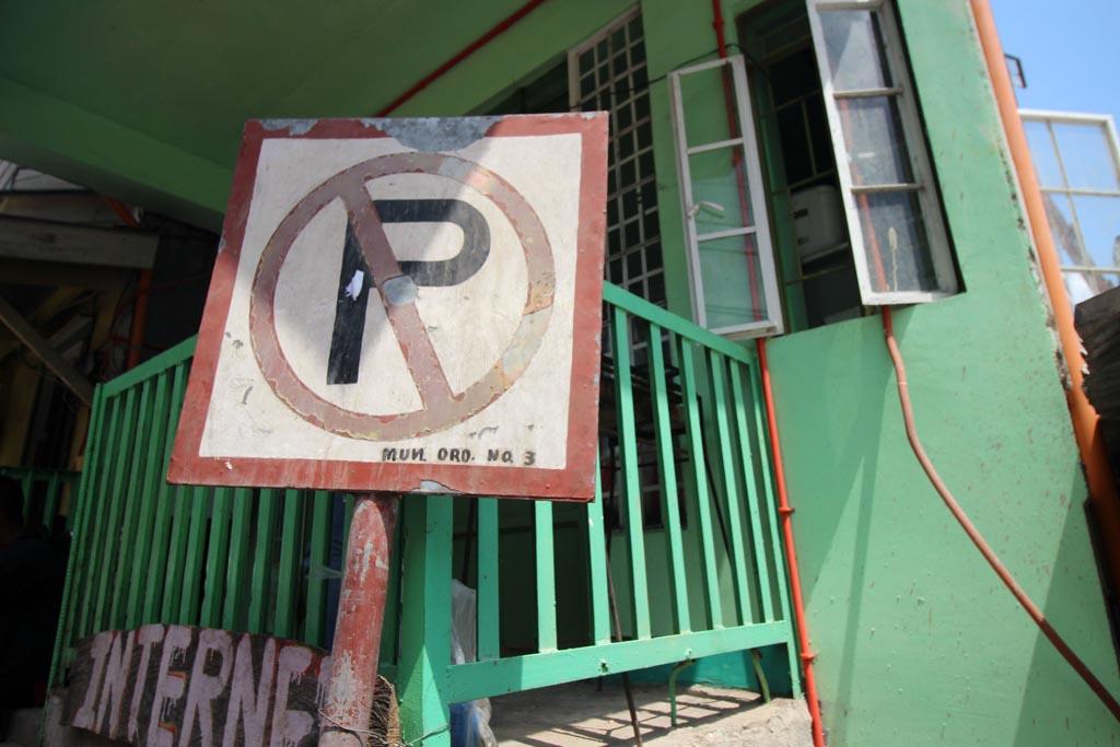 No Parking sign in front of house slash internet cafe