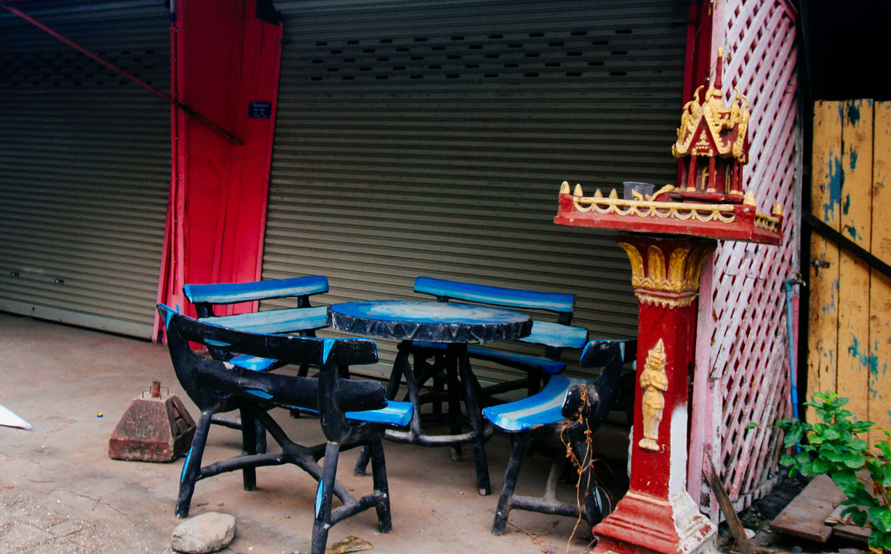 blue furniture and a Buddhist altar in front of a closed shop