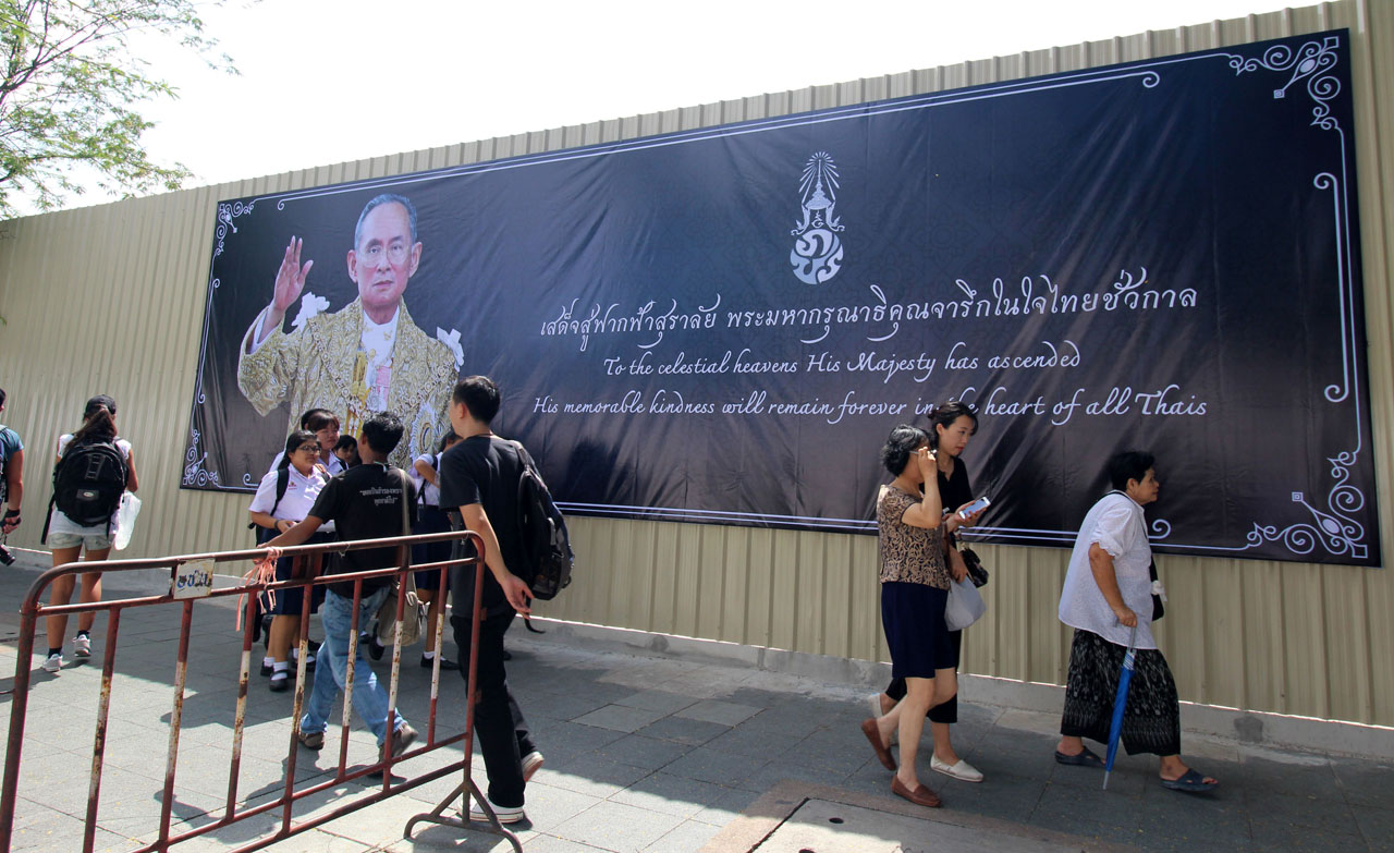 people in black mourning the Thai king