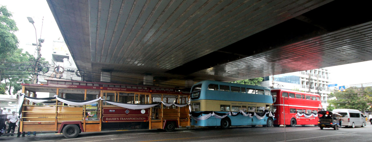 double decker bus to ferry mourners for the Thai king
