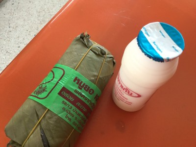 yogurt dairy drink and a sticky rice roll