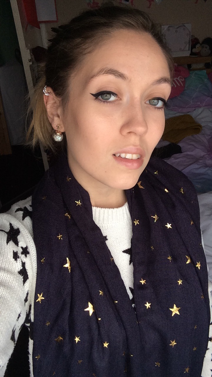 A blue scarf with golden stars on them.