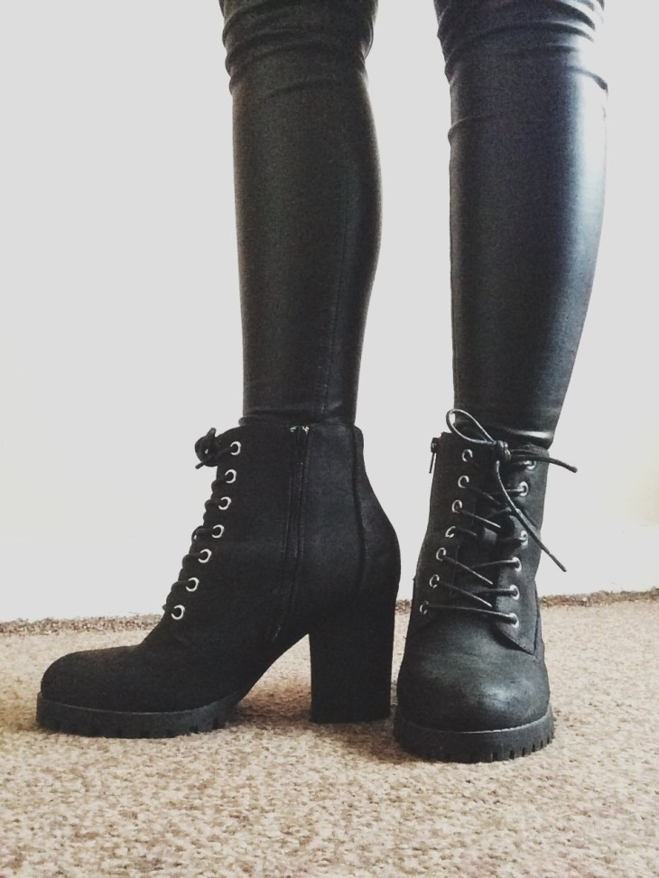 A pair of grey high heeled boots
