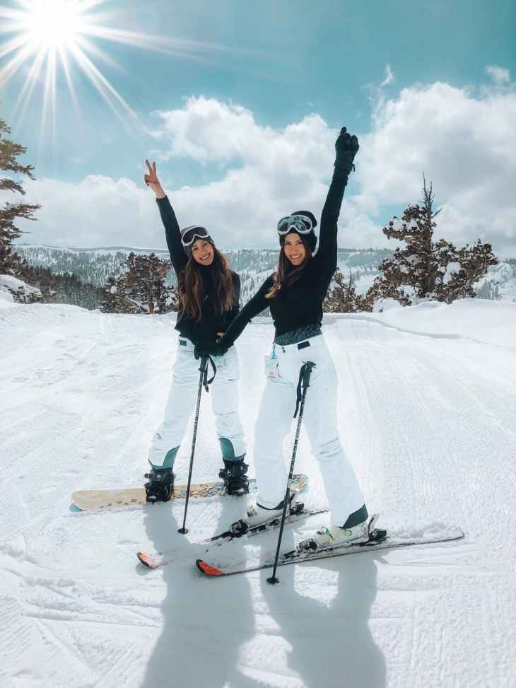 photo of two women skiing