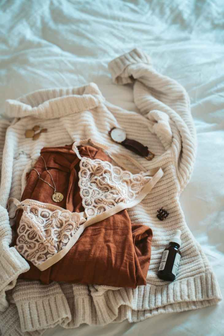 brown and white floral panty on white textile