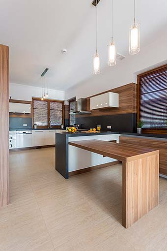 Interior of contemporary kitchen with wooden elements
