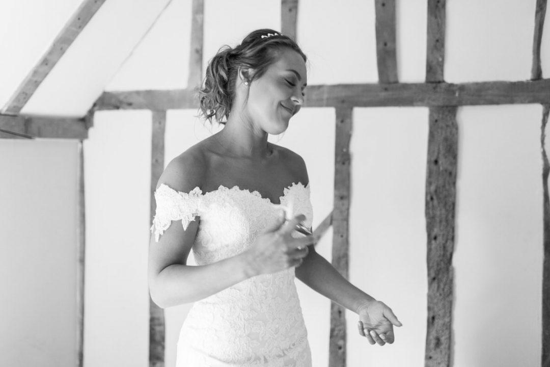 Bride putting on perfume