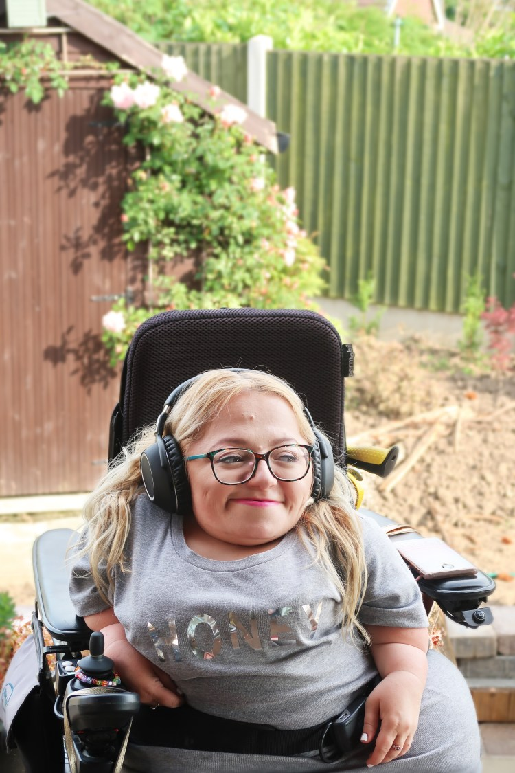 image of gem in the garden smiling with headphones on