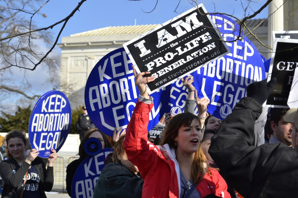 A Pro-Life woman clashes with a group of Pro-Choice demonstrators at the U.S. Supreme Court.