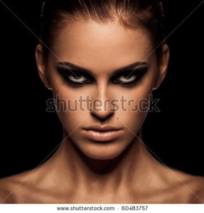 stock-photo-closeup-portrait-of-a-serious-lady-with-smoky-eye-makeup-60483757