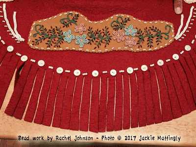 Photo of Bead work and fringe on tunic