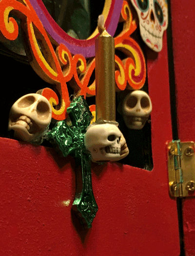 Photo of close up of skull candle holder.