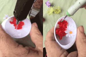 The small flowers in the egg are multi-purpose. First, They should look nice and be appropriate colors to go with your pictures. Additionally the flowers are used to help position the photos.
