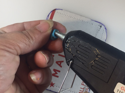 Photo showing gluing beads on the back of the photo.