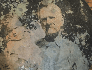 Hand colored photo on tin.