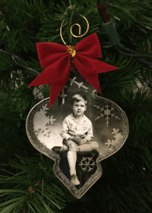 Cookie Cutter Christmas Ornament featuring a photograph of John L Whedbee Jr. when he was 6 years old.