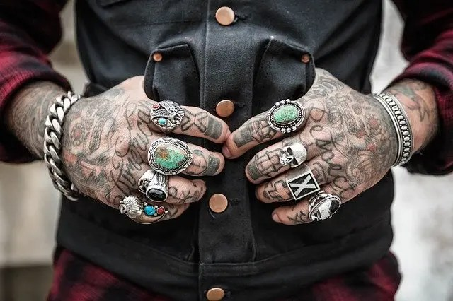Tattooed hands representing alternatives to breaking brick walls