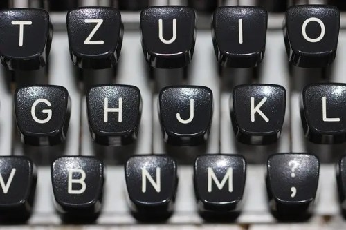Letters on a keyboard. OCR reads characters to transcribe text in newspapers.
