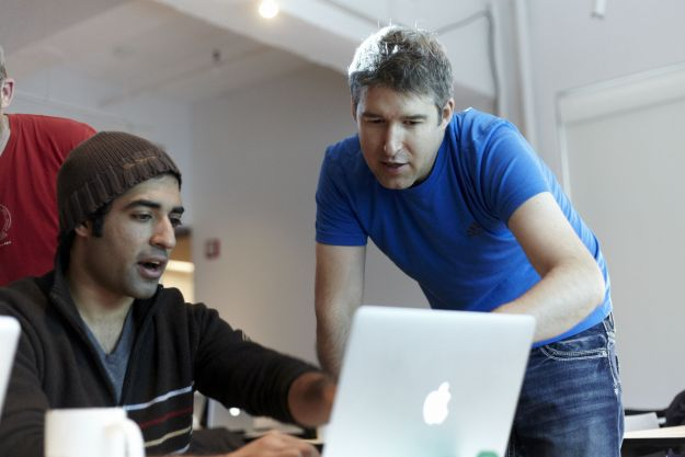 data scientist and web designer working together