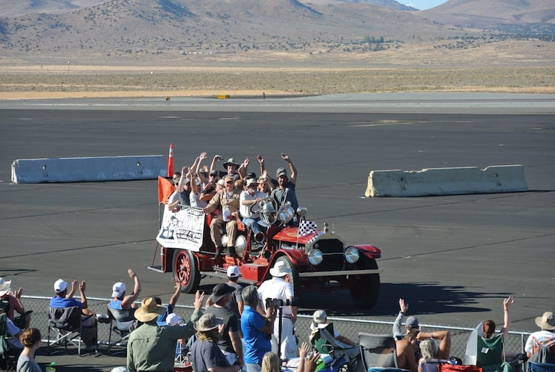 Reno tradition: Race winners parade in front of the crowd on an antique fire truck. (Photo by William E. Dubois)