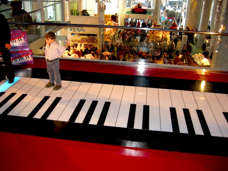 Walking piano, like the one in the film Big.