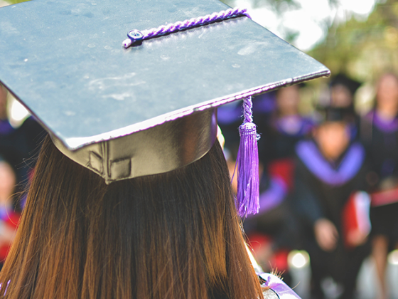 Woman standing at graduation ceremony