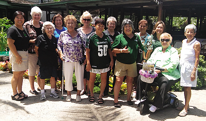 Kim Fujiuchi, Executive Director, front far left and women of Na Koa Football Club