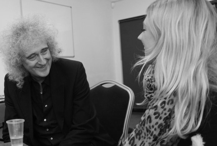 Journalist Bex Bastable interviewing Brian May