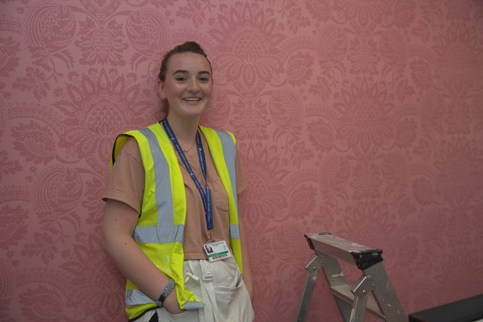 Roo Anderson is training in painting and decorating