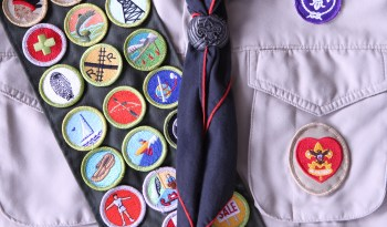 Sash with US Boy Scout badges on it.