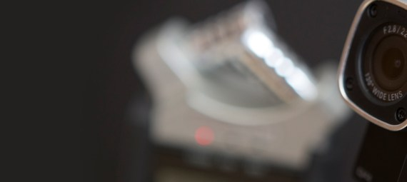 Close up of a camera viewfinder on a dark background.