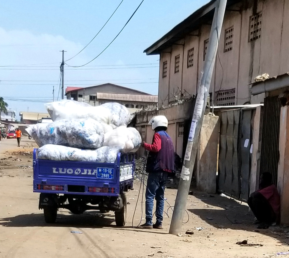 A tricycle delivers bags of sachet water in Greater Accra (photo credit: Dr. Mawuli Dzodzomenyo, University of Ghana)