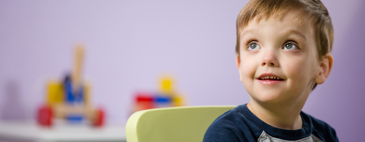 Genesis ABA Therapy Background with boy looking up