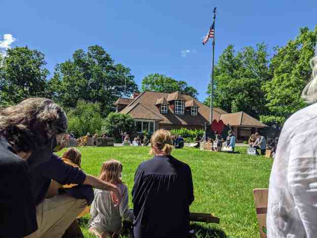 A group of citizens at a small town rally for Black Lives Matter kneel as a memorial to George Floyd