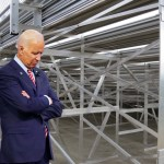 Biden behind bleachers when school lets out waiting for Trump to show