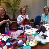 Volunteers knit sweaters credit HOBI International