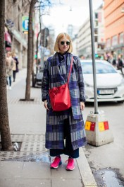 wearing coat, turtleneck and jeans from Rodebjer, bag from Mansur Gavriel and sneakers from Nike