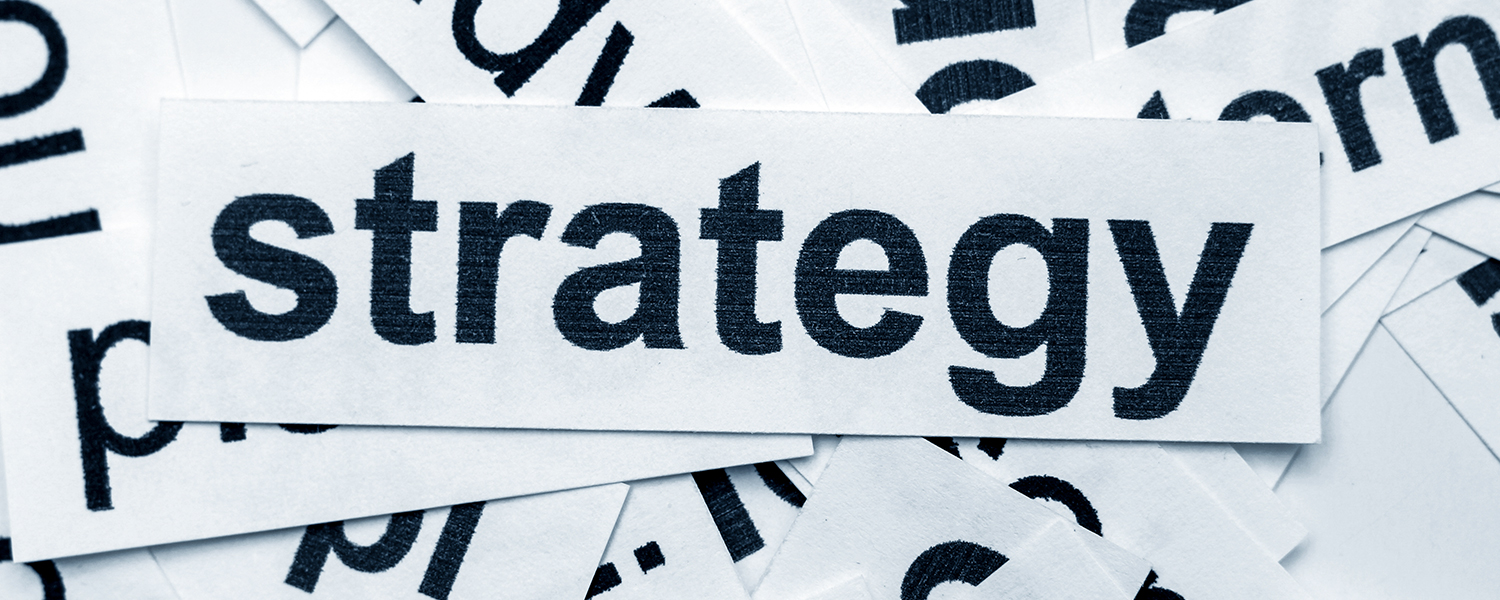 Cut paper that says Strategy