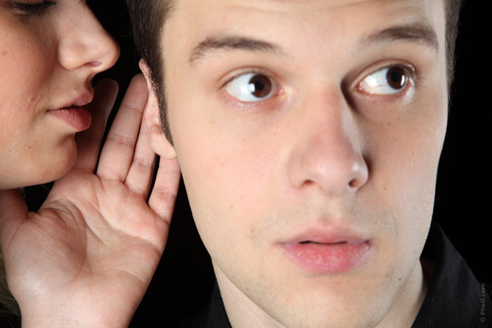 Image result for picture of a woman speaking into a man's ear