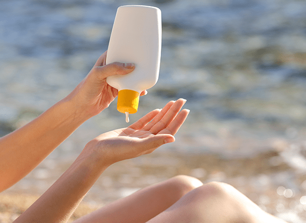 CRO_Health_Sunscreen_2015_Squeezing_Sunscreen_Out_of_Bottle_05-15