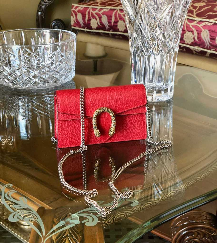 Gucci Dionysus mini bag displaying on a table.