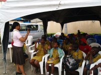 Children being advised and lectured at a training of GHAF.