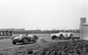 - Peter Collins leads in DB3S2 at Aintree ahead of Masten Gregory in his Ferrari 375MM_Courtesy of GPL Images