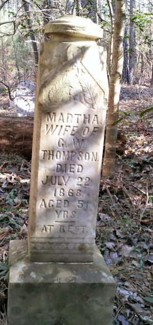 Martha Thompson, wife of GW Thompson on other side of marker.